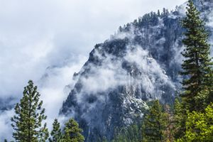 Rocky Cliff covered in clouds