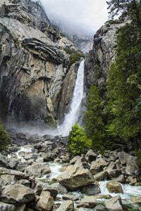 Waterfall on misty rocks