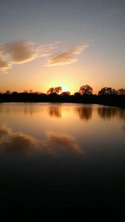 Texas sunset over Pond in Comanche - Brandon W. Ross