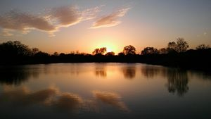 Sunset over water texas pond beauty