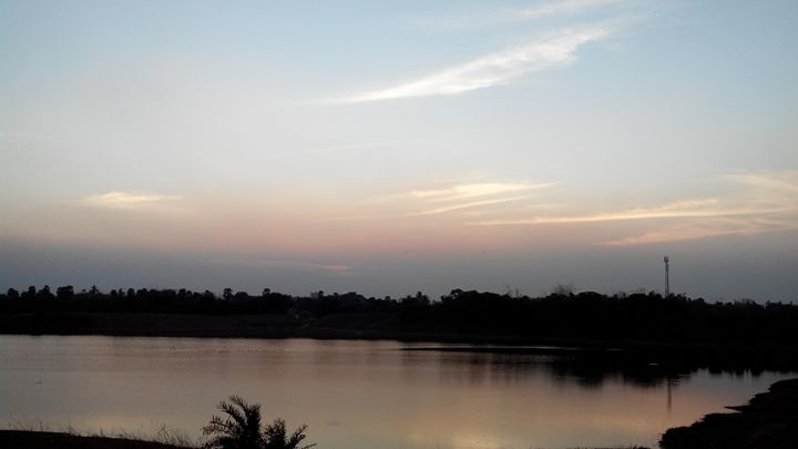 Sunset over lake - The Trickster
