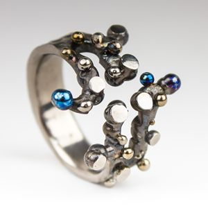 Spheres and Planes II. Titanium ring