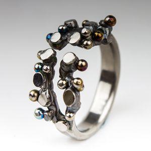 Spheres and Planes. Titanium ring