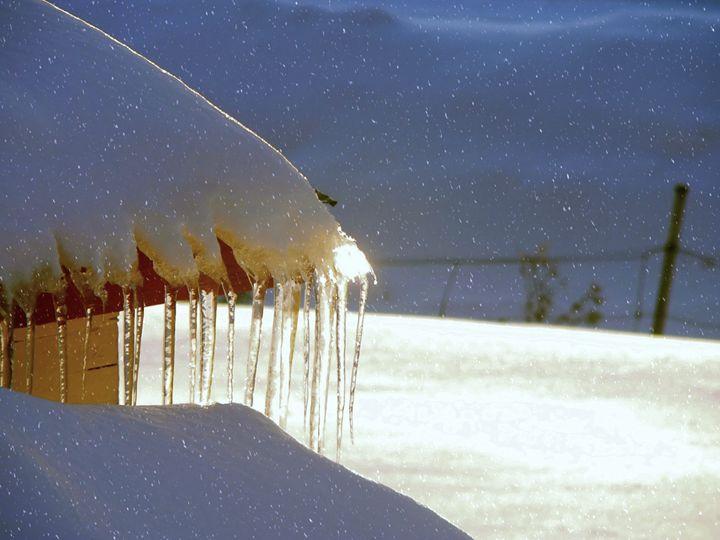 Melting snow-covered roof - imaginart
