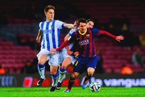 Lionel Messi of FC Barcelona duels f