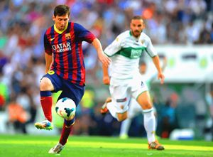 Lionel Messi controls the ball durin