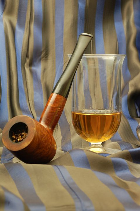 wooden pipe and glass of malt whiske - PhotoStock-Israel