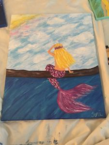 Perched mermaid viewing sunset