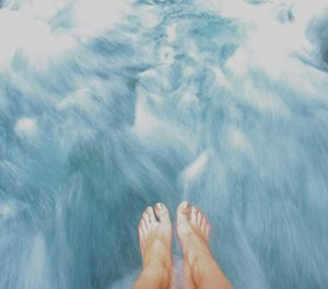 Feet floating on river/clouds