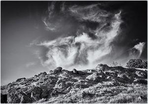 Wisp of clouds above rocks