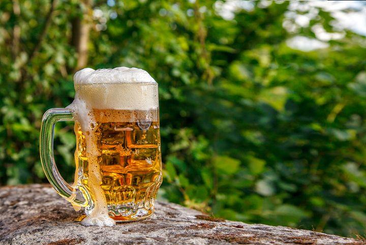 glass mug with beer standing on the - Radomir