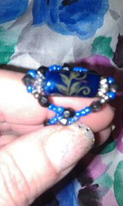 blue and black beaded ring