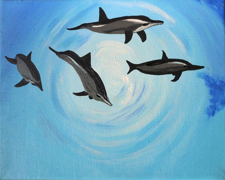 Dolphins in the sea - Amita Dand