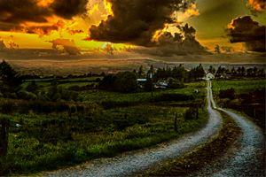 Sun setting over an Irish farm