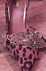 heel with butterfly necklace