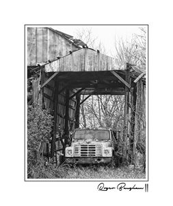 OLD TRUCK IN A BARN