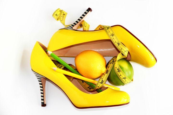 Measuring tape wrapped around lemon - Valentina Averina