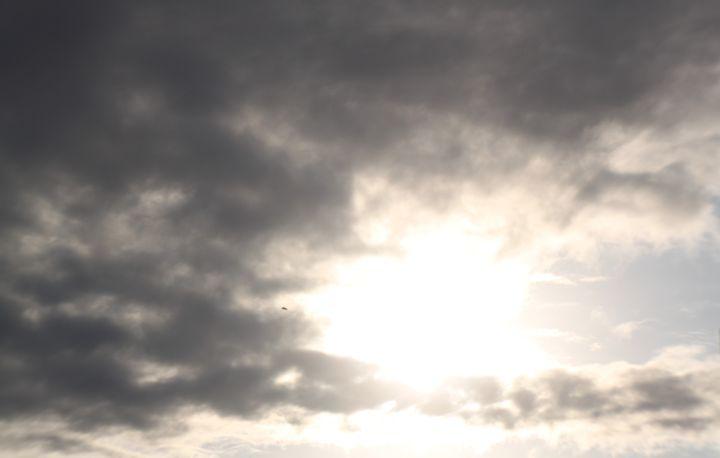 clouded sun - Jessica Roberto