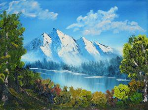 Snowcap Mountains by the lake