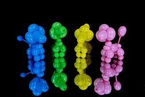 Four colorful balloon dog poodles