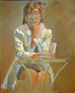 woman with drink at table