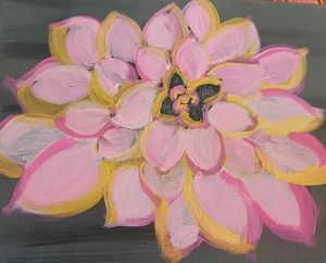 Pink flower on gray background