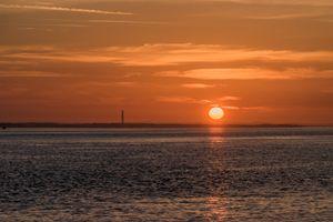 Industrial sunrise across the sea