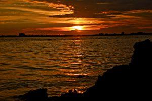 Sunset on the rocks at sea
