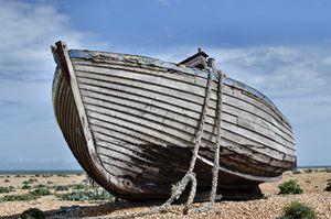 abandoned boat on beach