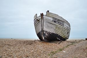 old boat on shingle