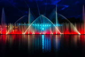 Night magic show of fountains on the
