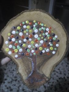 Tree of colour on wood slice