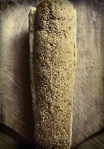 Fresh Baguette Bread on Chopping Boa