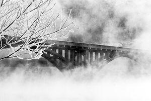 Bridge Over Foggy Waters