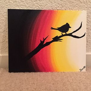 Sparrow on a Tree during a Sunset
