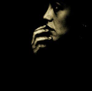 Portrait of young sad woman analog