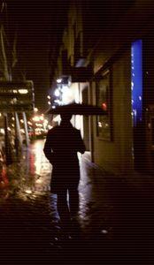 Man walking in street at night c41