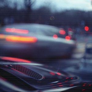 City lights cars in street at dusk