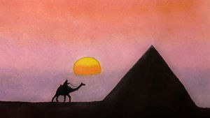 Sunset in desert with Pyramids of Eg