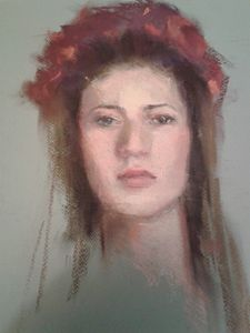 A woman with red flowers crown