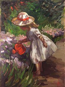 A girl watering flowers