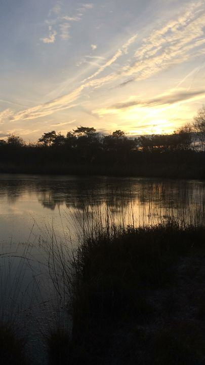 Last sunlight on a lake - Ingrid Huetten Photography