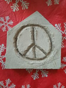 Home plate cut stone peace sign