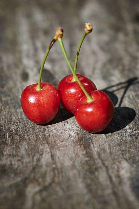 fresh cherries on table - pbombaert