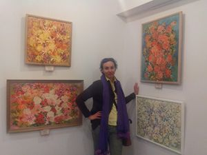 Katerina with her work at a gallery