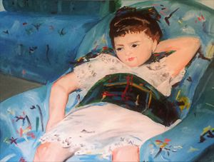Little girl in blue chair