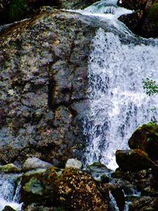 Alaskan waterfall over rocks