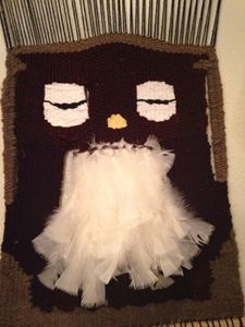 Hand woven owl tapestry with feather