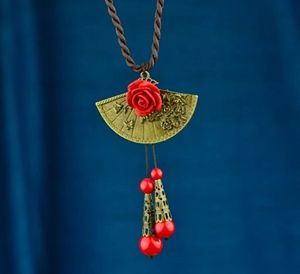 Sweater Necklace with Red Flower