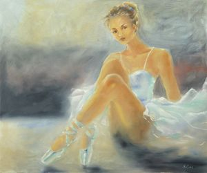 Seated Ballerina in white dress